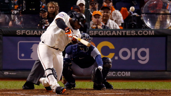 Pablo Sandoval of the San Francisco Giants hits a solo home run to center field against Al Alburquerque of the Detroit Tigers in the fifth inning of Game 1.