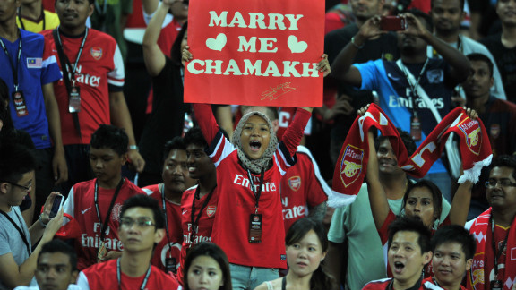 The appetite for the English Premier League abroad is insatiable, as proved by these fans watching Arsena in a preseason game in Malaysia. But when the prospect of a 39th league game, staged abroad, was mooted it was met by anger from British fans.