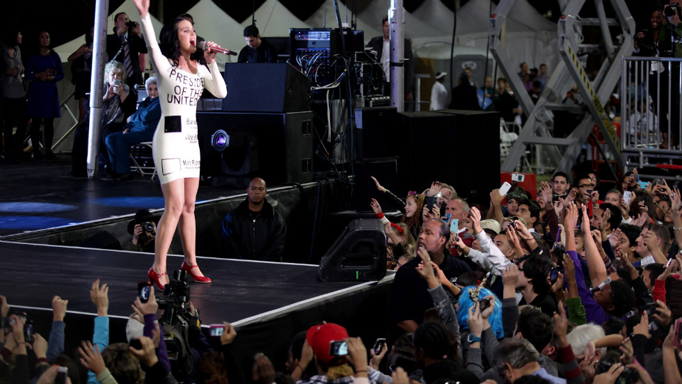 Katy Perry performed Wednesday at a rally for President Obama in Las Vegas wearing a white rubber dress printed with the image of a presidential ballot.