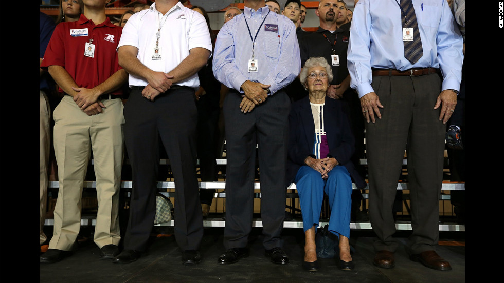 Supporters look on as Romney speaks during a campaign rally at Jet Machine in Cincinnati.