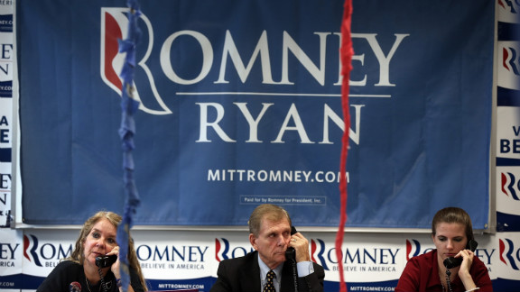Volunteers make phone calls seeking support for Romney at his Arlington Victory Center in Virginia.