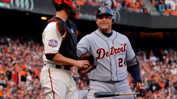 Miguel Cabrera of the Detroit Tigers greets Buster Posey of the San Francisco Giants as Cabrera takes his first at bat.