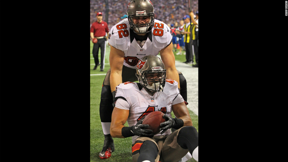 Erik Lorig and Nate Byham of the Tampa Bay Buccaneers celebrate Lorig's touchdown against the Minnesota Vikings on Thursday.