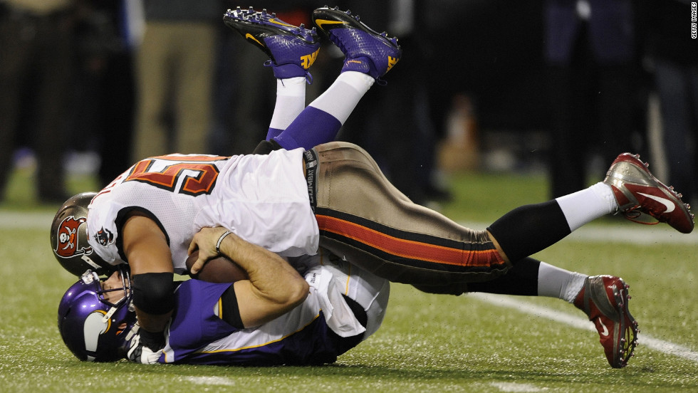 Christian Ponder of the Minnesota Vikings is sacked by Daniel Te'o-Nesheim of the Tampa Bay Buccaneers during the second quarter of the game Thursday.