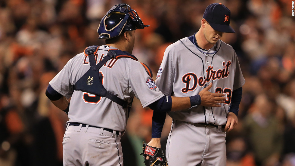 Catcher Gerald Laird of the Detroit Tigers talks with pitcher Drew Smyly on the mound.