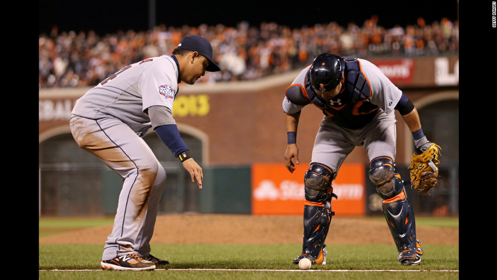 Miguel Cabrera, left, and Gerald Laird of the Detroit Tigers wait to see if a ball hit by Gregor Blanco of the San Francisco Giants will roll foul or stay in play.