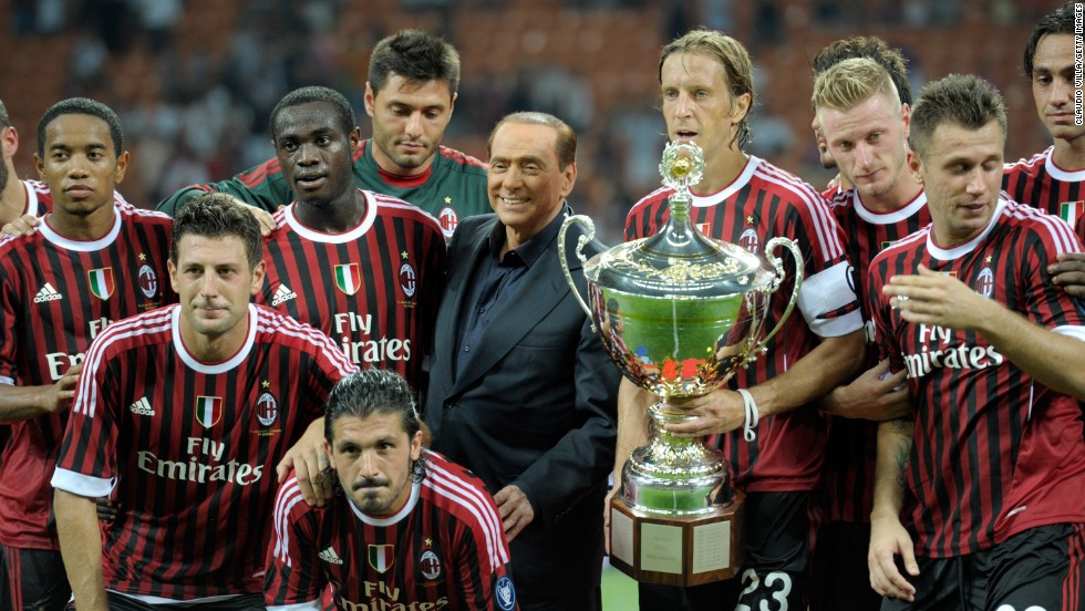 AC Milan players and AC Milan chairman Berlusconi celebrate after winning the Luigi Berlusconi Trophy at Giuseppe Meazza Stadium on August 21, 2011, in Milan, Italy.