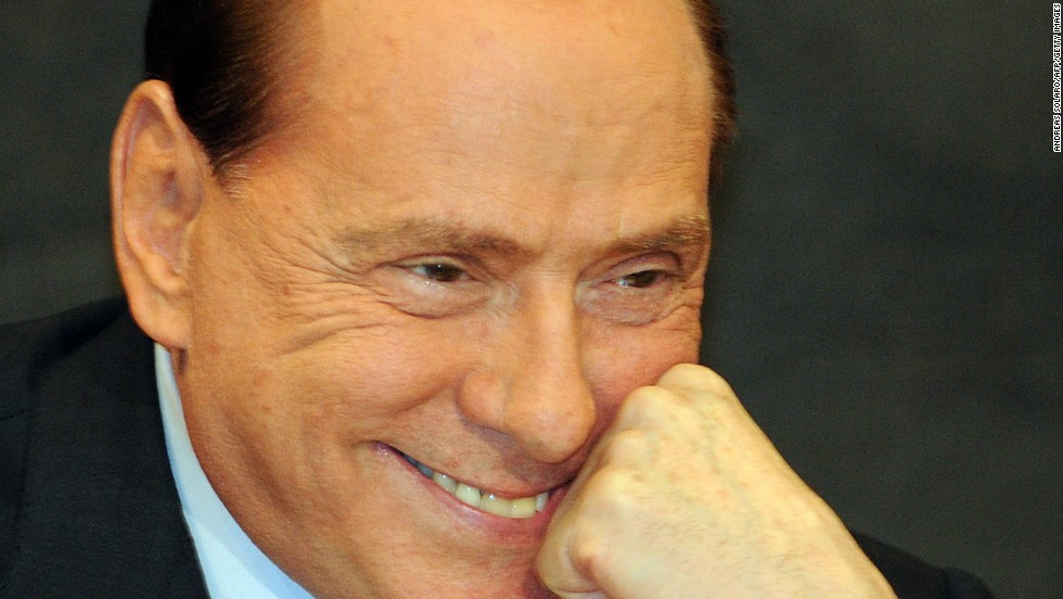 "Berlusconi reacts during the presentation of  Antonio Razzi's book ""My Clean Hands"" at the Italian Parliament in February 2012."
