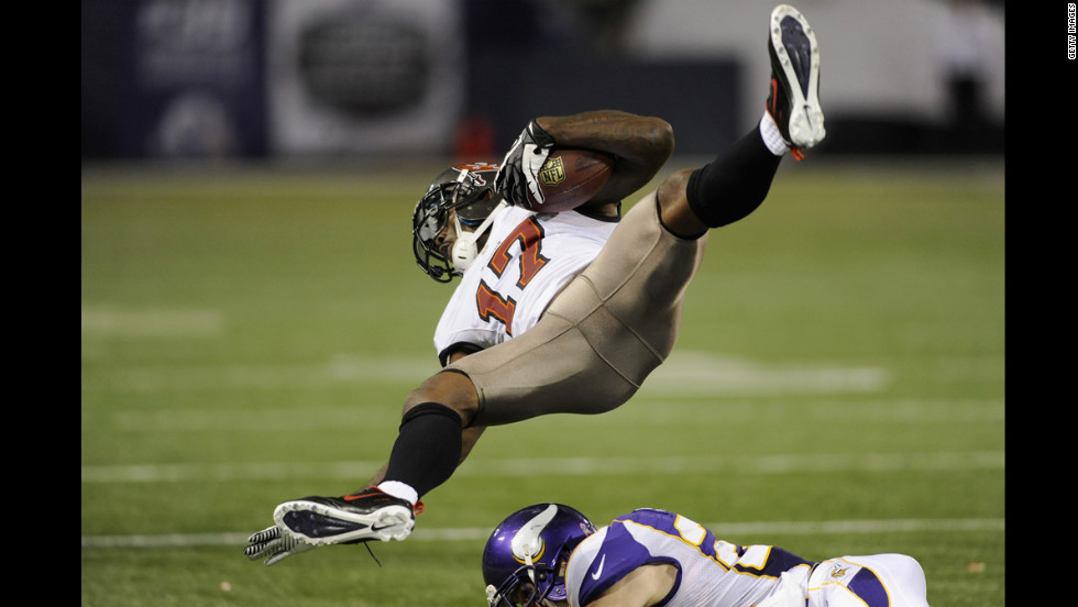 Arrelious Benn of the Tampa Bay Buccaneers flies into the air after a tackle by Harrison Smith of the Minnesota Vikings during the fourth quarter of the game on Thursday, October 25, at Mall of America Field at the Hubert H. Humphrey Metrodome in Minneapolis. The Buccaneers defeated the Vikings 36-17.