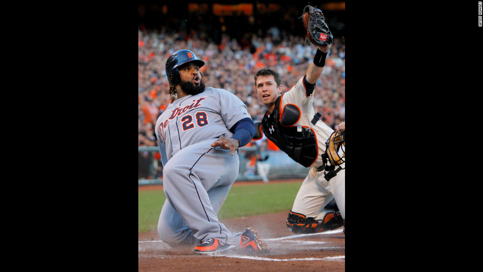 Prince Fielder of the Detroit Tigers is tagged out at home plate by catcher Buster Posey of the San Francisco Giants in the second inning.