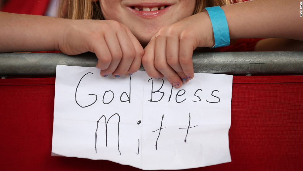 A young Romney supporter holds a homemade sign during a campaign rally at Ranger Jet Center on Saturday in Kissimmee, Florida.