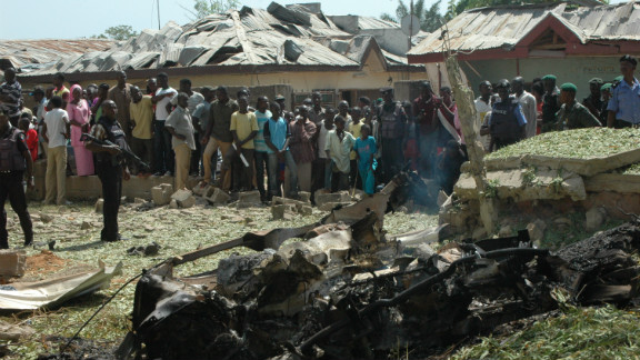 Soldiers stand guard after a suicide attacker drove a car bomb into a church in Kaduna, Nigeria.