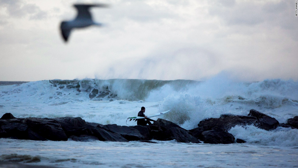 A man surfs at Rockaway Beach in Queens as Hurricane Sandy approaches Sunday.