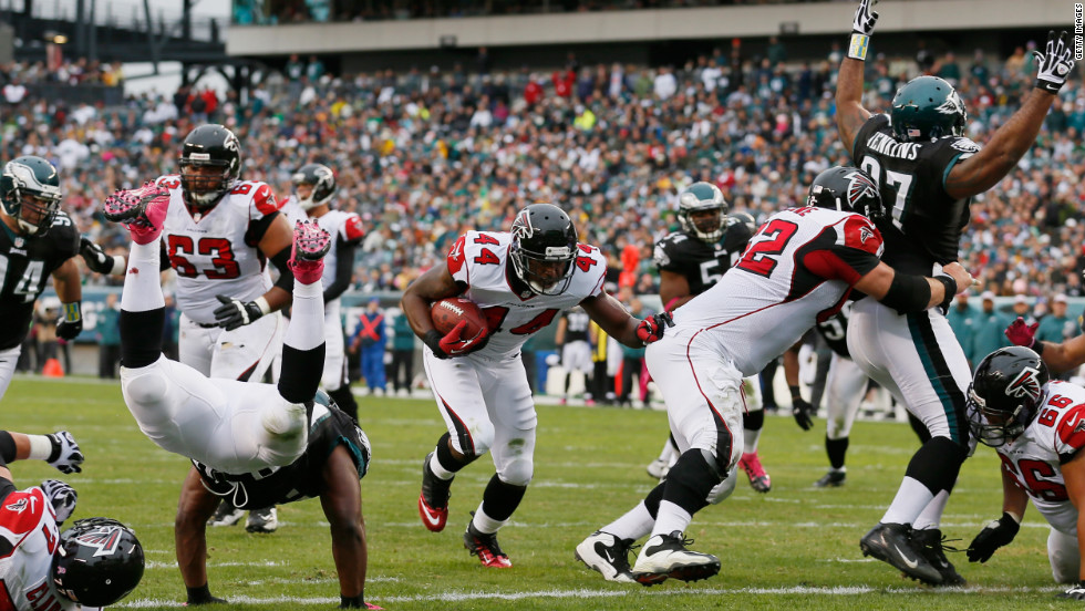Fullback Jason Snelling of the Atlanta Falcons carries the ball for a first quarter touchdown against the Philadelphia Eagles on Sunday in Philadelphia.