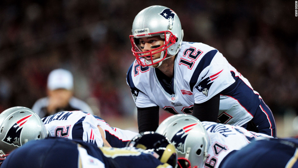 New England's Tom Brady prepares to take a snap during Sunday's game.