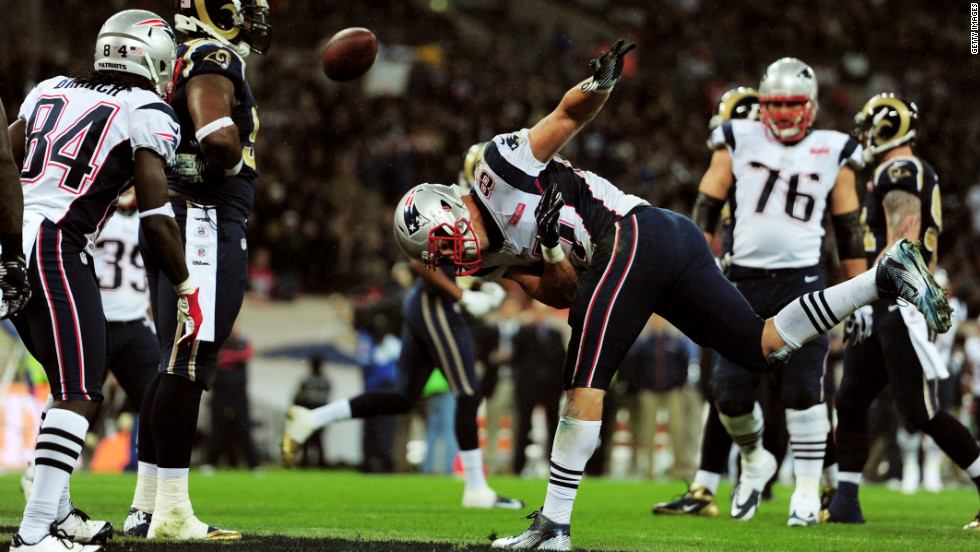 Rob Gronkowski of the New England Patriots celebrates by spiking the ball after scoring his team's third touchdown against the St. Louis Rams on Sunday at Wembley Stadium in London.