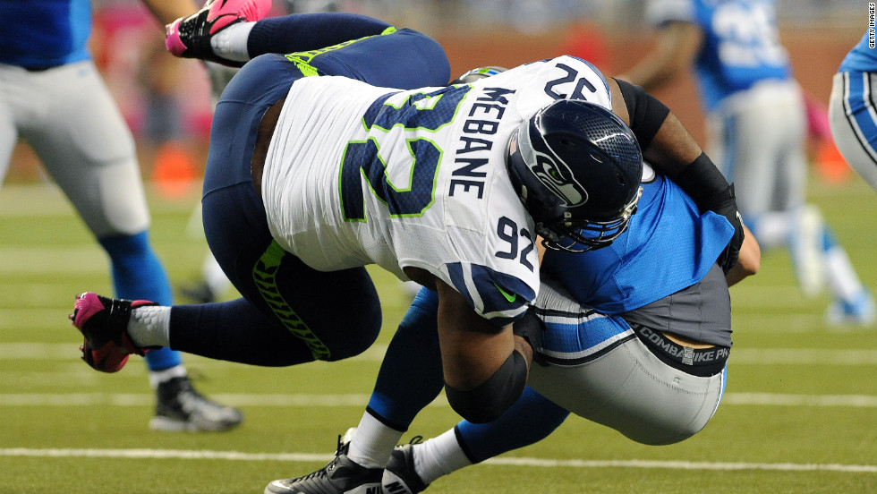 Defensive tackle Brandon Mebane of the Seattle Seahawks sacks quarterback Matthew Stafford of the Detroit Lions on Sunday at Ford Field in Detroit.