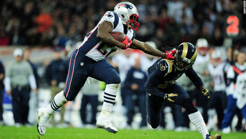 Stevan Ridley of the New England Patriots pushes Janoris Jenkins of the St. Louis Rams during Sunday's game at Wembley Stadium on Sunday in London.