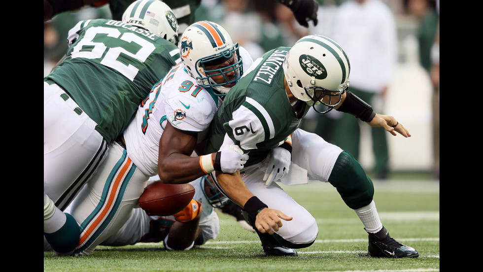Defensive end Cameron Wake of Miami tackles quarterback Mark Sanchez of New York on Sunday.