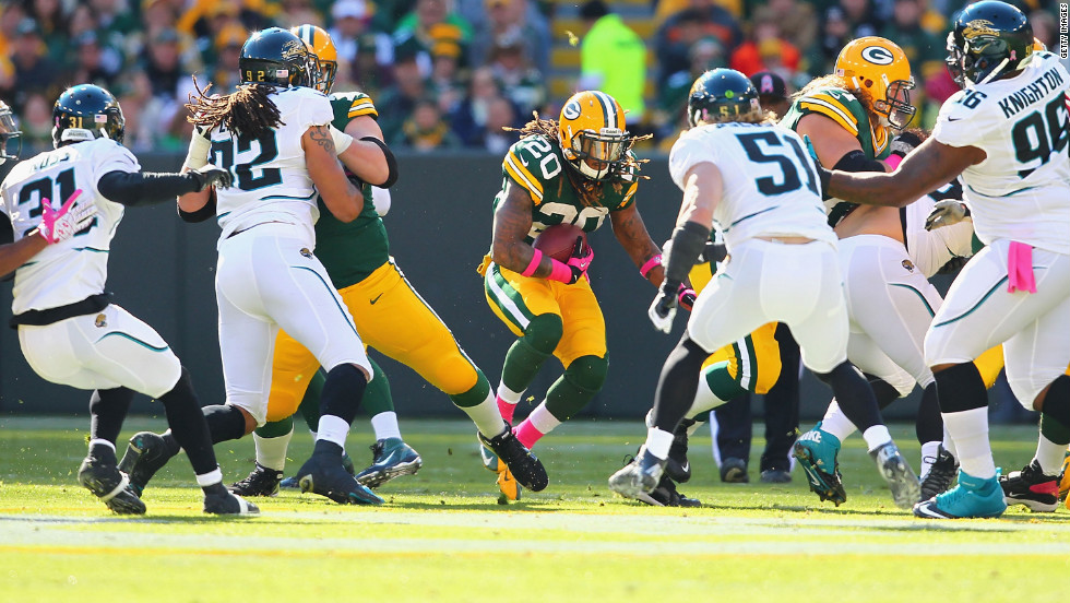 No. 20 Alex Green of the Green Bay Packers rushes against the Jacksonville Jaguars at Lambeau Field on Sunday in Green Bay, Wisconsin.