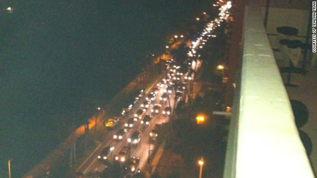 Cars are seen on Ala Wai Blvd. in Honolulu's Waikiki in Hawaii on Saturday before the arrival of the first tsunami waves.