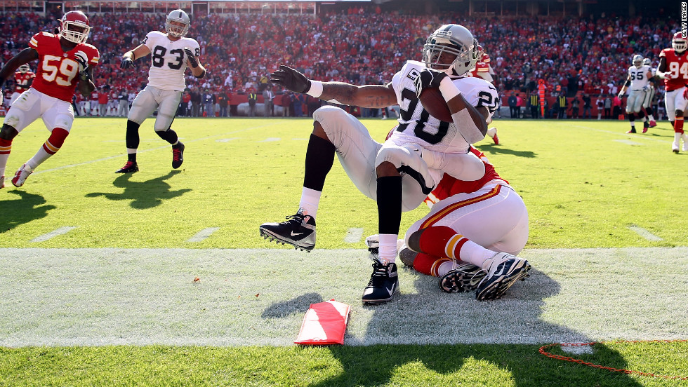 Running back Darren McFadden of the Raiders is tackled out-of-bounds at the first-down marker during the game against the Chiefs on Sunday.