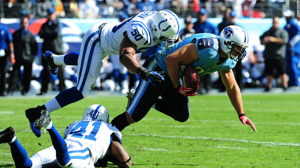No. 88 Craig Stevens of the Tennessee Titans is tackled by No. 50 Jerrell Freeman and No. 41 Antoine Bethea of the Indianapolis Colts at LP Field on Monday in Nashville, Tennessee.