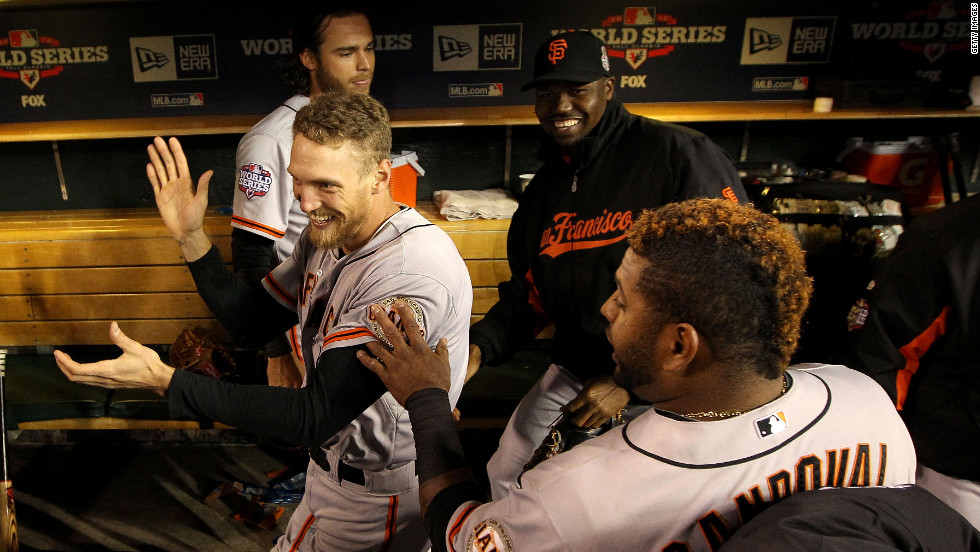 Pablo Sandoval of the Giants jokes with teammate Hunter Pence in the dugout prior to Saturday's Game 3.