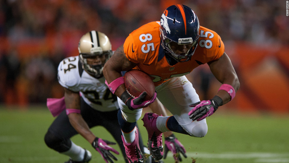 Tight end Virgil Green of the Denver Broncos dives for yards after the catch during a game against the Saints.