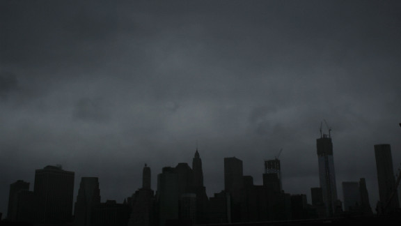 Dark clouds cover the skyline of Manhattan early Monday.