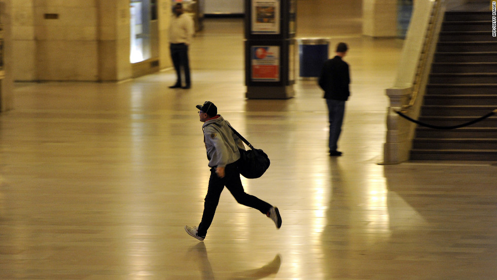 A man runs to make the last Metro North Train as the last people are cleared out of Grand Central Station on October 28.  The MTA began an orderly shutdown of commuter rail and subway service in preparation for Hurricane Sandy.