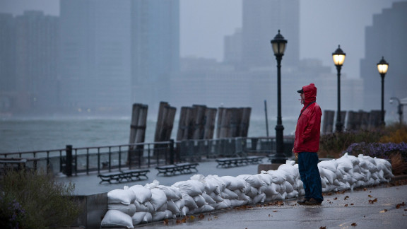 A man watches the waves in New York Harbor from Battery Park on October 29. The core of Sandy