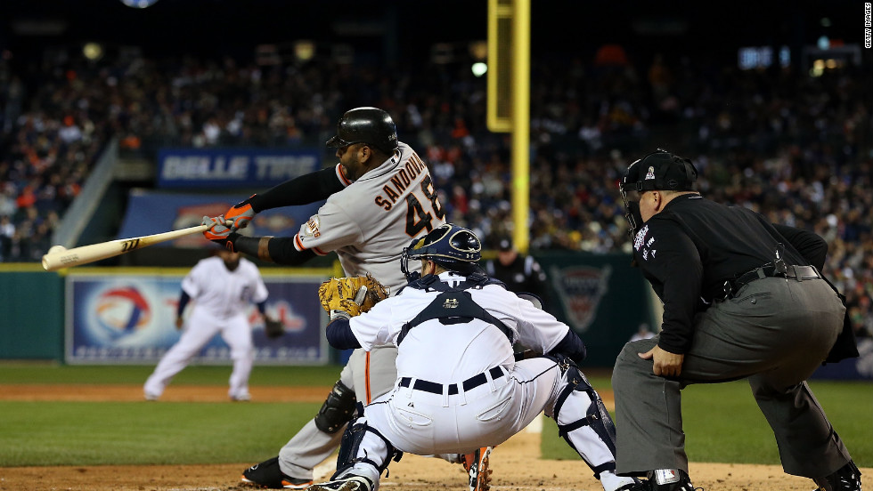 Pablo Sandoval of the Giants hits a single to right field against Max Scherzer of the Tigers in the third inning.
