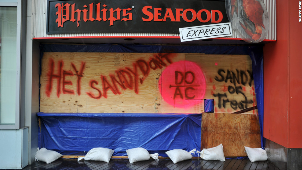 A restaurant on the boardwalk in Atlantic City, New Jersey, is boarded up in preparation for the bad weather on Monday.