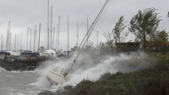 A sailboat smashes on the rocks after breaking free from its mooring on City Island, New York, on Monday.
