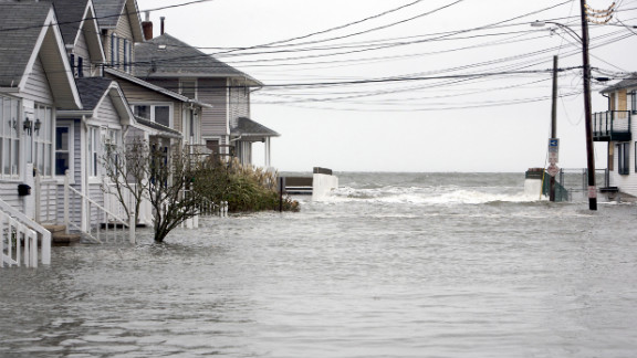 A street on the shoreline of Milford, Connecticut, floods at high tide as Hurricane Sandy approaches on Monday.