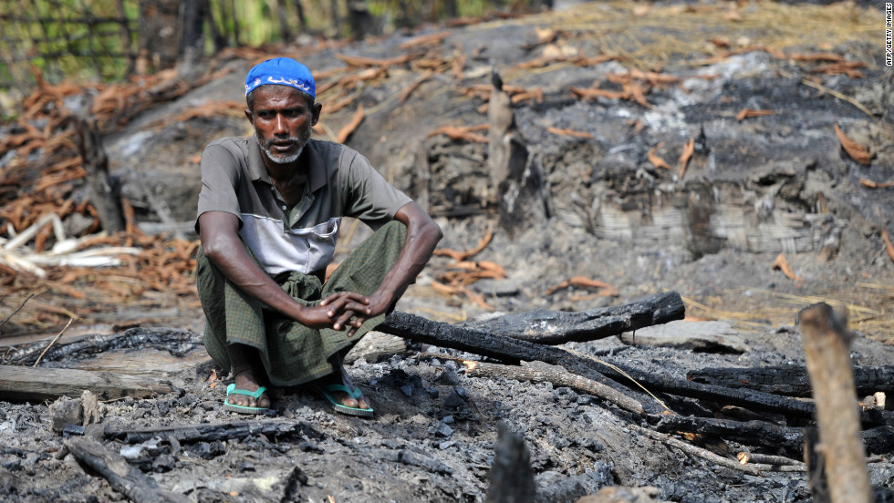 "A Muslim Rohingya man sits at the site of his burnt-out home at a village in Minpyar in Rakhine state on Sunday.The U.N. said it seen ""large-scale"" destruction of houses."