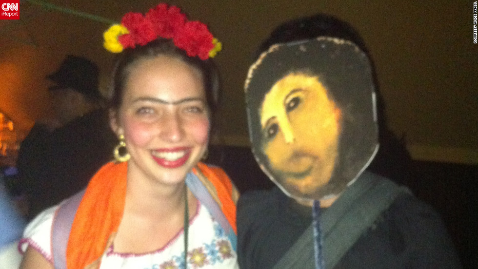 "<a href=""http://ireport.cnn.com/docs/DOC-865461"">Alice Feigel</a>, dressed as Frida Kahlo on the left, is standing next to Internet meme <a href=""http://knowyourmeme.com/memes/events/botched-ecce-homo-painting"" target=""_blank"">Botched Ecce Homo Painting</a>. The meme when viral online after the <a href=""http://news.blogs.cnn.com/2012/08/23/church-masterpiece-restored-as-mr-bean-would-do-it/"">failed restoration</a> of a century-old fresco of Jesus Christ."