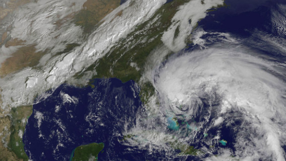 "A satellite view of Hurricane Sandy shows the storm at 10:15 a.m. ET on Friday, October 26. Though it was no longer considered a hurricane when it hit the U.S., ""post-tropical"" Superstorm Sandy packed a hurricane-sized punch."