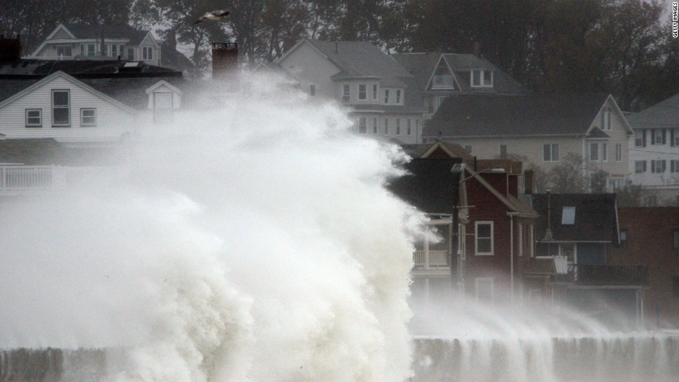 Waves crash over a street in Winthrop, Massachusetts, as Hurricane Sandy comes up the coast on Monday.
