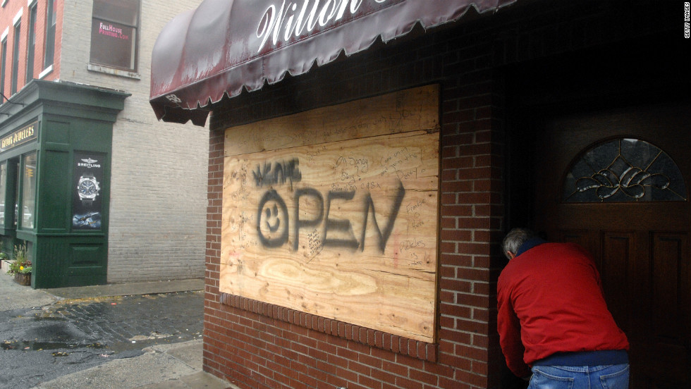 The owner of the Wilton House locks up his bar on Monday in Hoboken, New Jersey, as Hurricane Sandy approaches the area.