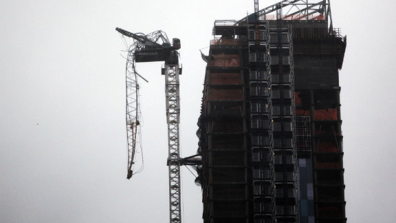 High winds broke part of a crane boom on this building under construction in Manhattan, causing several nearby buildings to be evacuated.