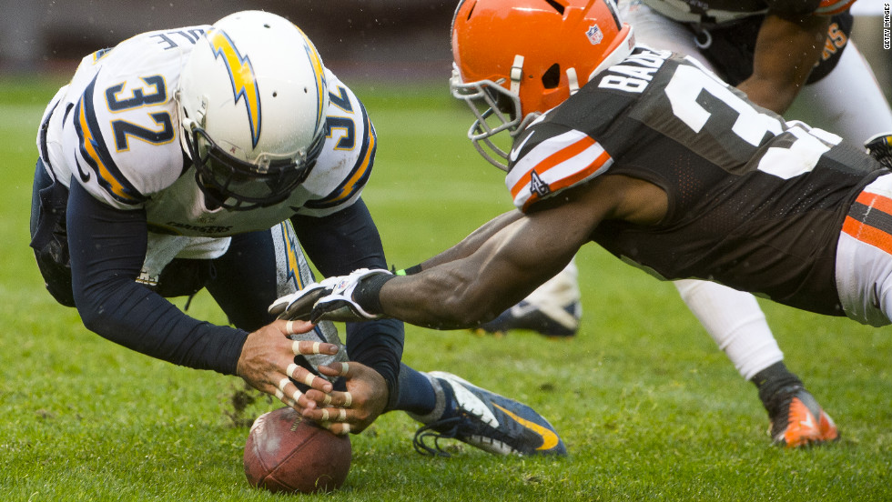 Free safety Eric Weddle of the Chargers jumps on a loose ball as cornerback Johnson Bademosi of the Browns reaches for it during the second half on Sunday.
