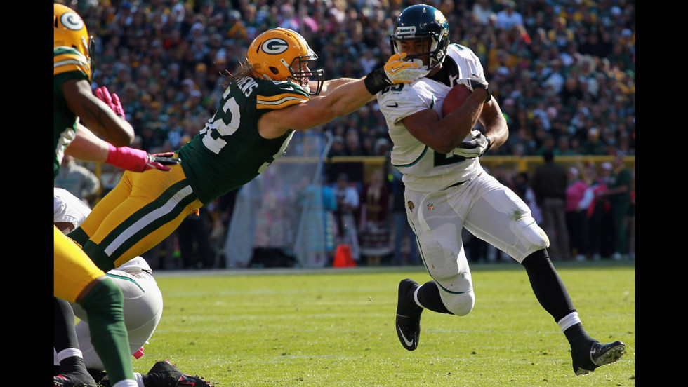 Dwight Lowery of the Jacksonville Jaguars is tackled by Clay Matthews of the Green Bay Packers at Lambeau Field in Green Bay, Wisconsin, on Sunday.