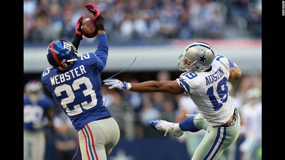 Corey Webster of the New York Giants intercepts a pass intended for Miles Austin of the Dallas Cowboys in Arlington, Texas, on Sunday.