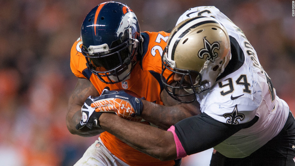 Defensive end Cameron Jordan of the New Orleans Saints tackles running back Willis McGahee of the Denver Broncos in Denver on Sunday. The Broncos beat the Saints 34-14.