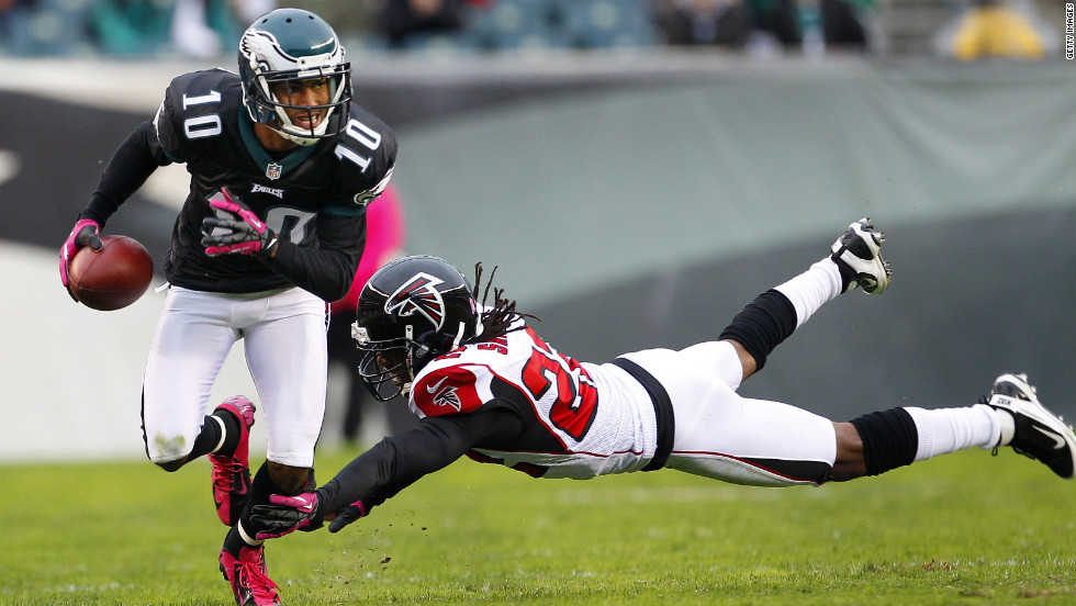 Eagles wide receiver DeSean Jackson runs past the Falcons' Asante Samuel during the first half.