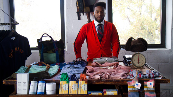 """Najee Redd, store manager of <a href=""""http://www.sirandmadame.com/"""" target=""""_blank"""" target=""""_blank"""">Sir & Madame</a> in Chicago, displays American-made clothing and accessories available at the store."""