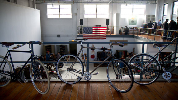 Handcrafted bicyles from Chicago's Heritage General Store, a hybrid coffee shop and full-service bike shop, adorn the showroom.