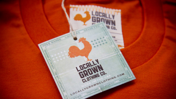 """Each NorthernGRADE vendor has a story behind its business. <a href=""""http://locallygrownclothing.com/"""" target=""""_blank"""" target=""""_blank"""">Locally Grown</a> has evolved from an Iowa-based T-shirt company into a nationally recognized brand that promotes farmers' markets and local agriculture."""